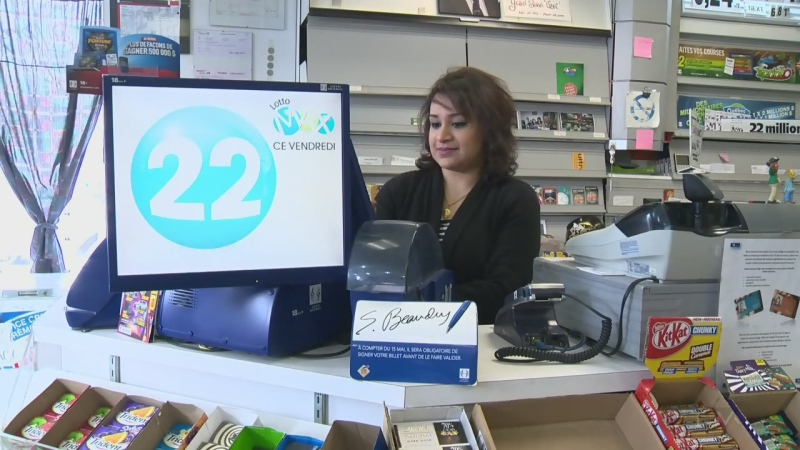 A woman stands behind a Loto Quebec counter