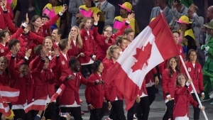 Rosie MacLennan carries the flag as she leads Canada into the opening ceremonies for the 2016 Summer Olympics Friday August 5, 2016 in Rio de Janeiro, Brazil. (Frank Gunn/ THE CANADIAN PRESS)