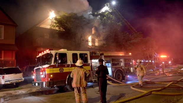 Firefighters are seen outside a home on fire on Niagara Street in Hamilton on Aug. 6 (Andrew Collins)
