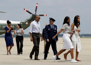 U.S. President Barack Obama with first lady Michelle Obama and their daughters Malia Obama and Sasha Obama board the Air Force One at Andrews Air Force Base, Md., Saturday, Aug. 6, 2016, for a family vacation in the Massachusetts island of Martha's Vineyard. (AP / Manuel Balce Ceneta)