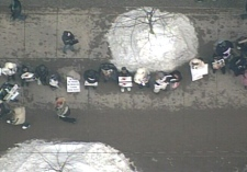 The protesters attempt to construct a roughly 5-kilometre human chain in Toronto on Friday, Jan. 30, 2009.