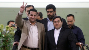 In this July 15, 2010 file photo, Shahram Amiri, an Iranian nuclear scientist flashes a victory sign as he arrives to the Imam Khomeini airport just outside Tehran, Iran, from the United States. Amiri, who was caught up in a real-life U.S. spy mystery and later returned to his homeland and disappeared, has reportedly been executed under similarly mysterious circumstances. (AP Photo/Vahid Salemi, File)