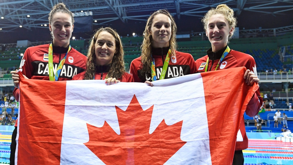 The Canadian women's 4x100-metre freestyle relay team, left to right, Chantal van Landeghem, Sandrine Mainville, Penny Oleksiak and Taylor Ruck show off their bronze medal at the 2016 Summer Olympics, in Rio de Janeiro, Brazil, Saturday, Aug. 6, 2016. (Frank Gunn/The Canadian Press)