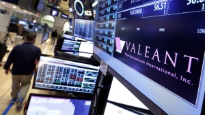 In this March 15, 2016 file photo, a trading post on the floor of the New York Stock Exchange displays the Valeant Pharmaceuticals logo. (THE CANADIAN PRESS/AP/Richard Drew)