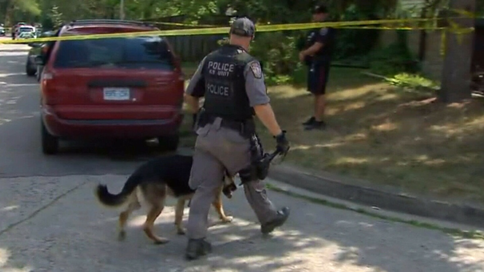 Hamilton police conduct a search after cancelling an Amber Alert on Sunday, Aug. 7, 2016.