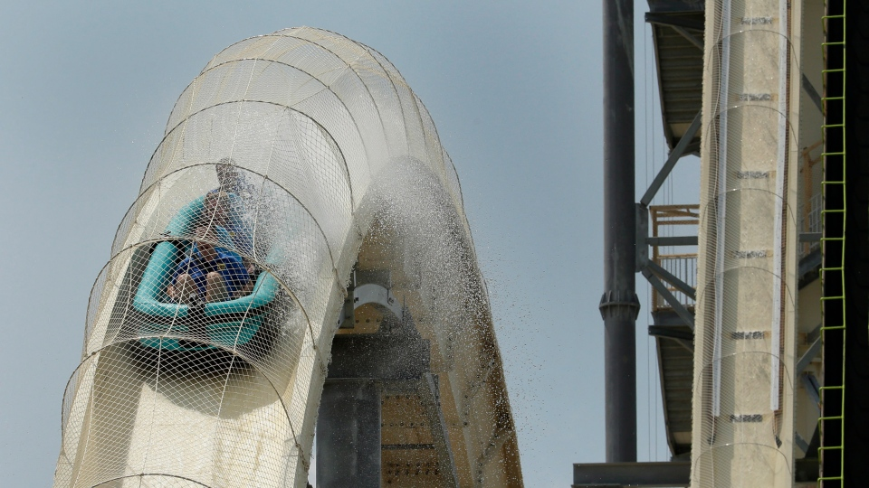 "Riders are propelled by jets of water as the go over a hump while riding the world's tallest water slide called ""Verruckt"" at Schlitterbahn Waterpark, Wednesday, July 9, 2014, in Kansas City, Kan. (AP / Charlie Riedel)"