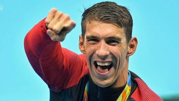 Michael Phelps celebrates after winning gold