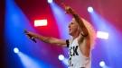 Dee Snider takes takes part in the show of the Brazilian metal band Angra at the Rock in Rio music festival in Rio de Janeiro, Brazil, Saturday, Sept. 19, 2015. (AP Photo/Felipe Dana)