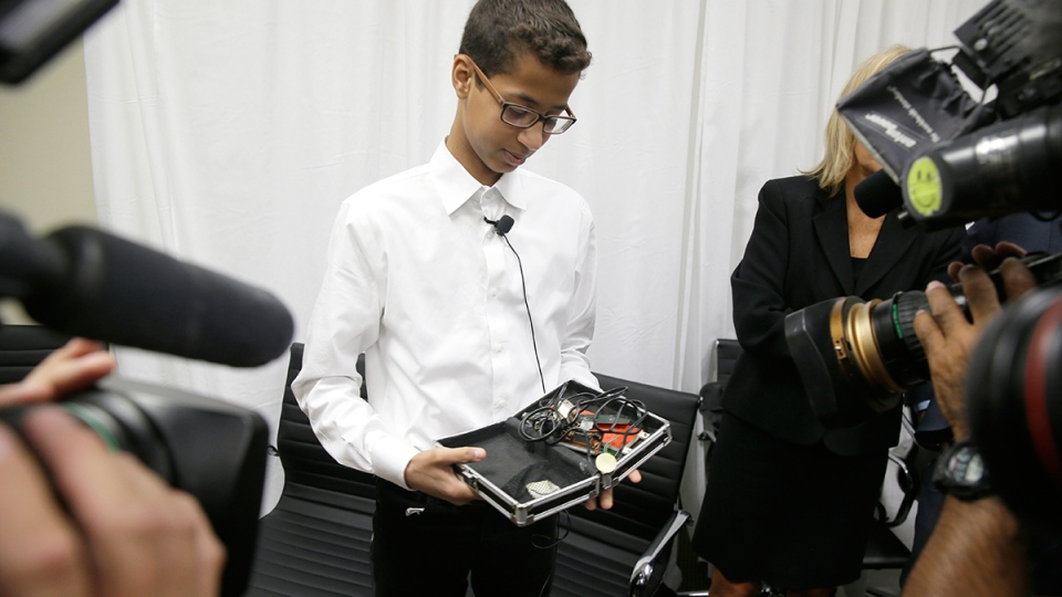 Ahmed Mohamed shows the clock he built in a school pencil box to reporters after a news conference in Dallas, Monday, Aug. 8, 2016. (AP / LM Otero)