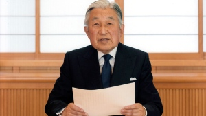 Japan's Emperor Akihito reads a message for recording at the Imperial Palace in Tokyo on Sunday, Aug. 7, 2016. (Imperial Household Agency of Japan)