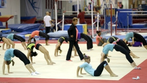 Martha Karolyi, national team coordinator for USA Gymnastics, watches over gymnasts during a training session at the Karolyi Ranch, in New Waverly, Texas on Sept. 12, 2015. (AP / David J. Phillip)