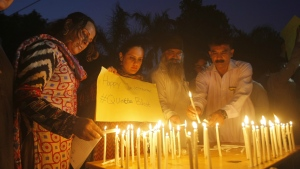 Pakistani civil society activists light candles Peshawar, Pakistan to pay tribute to the victims of a bombing in Quetta on Monday, Aug. 8, 2016. (AP / Mohammad Sajjad)