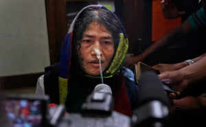 India's hunger-striking activist Irom Sharmila addresses a press conference after a court appearance in Imphal in the north-eastern state of Manipur, India, Tuesday, Aug. 9, 2016. (AP Photo/Anupam Nath)