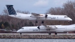 A Porter Airlines plane lands next to a taxiing plane at Toronto's Island Airport on Friday, November 13, 2015. THE CANADIAN PRESS/Chris Young