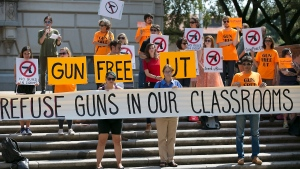 In this Oct. 1, 2015 file photo, protestors gather at the Austin campus of the University of Texas to oppose a new state law that expands the rights of concealed handgun license holders to carry their weapons on public college campuses as of Aug. 1, 2016. (Ralph Barrera/Austin American-Statesman via AP, File)