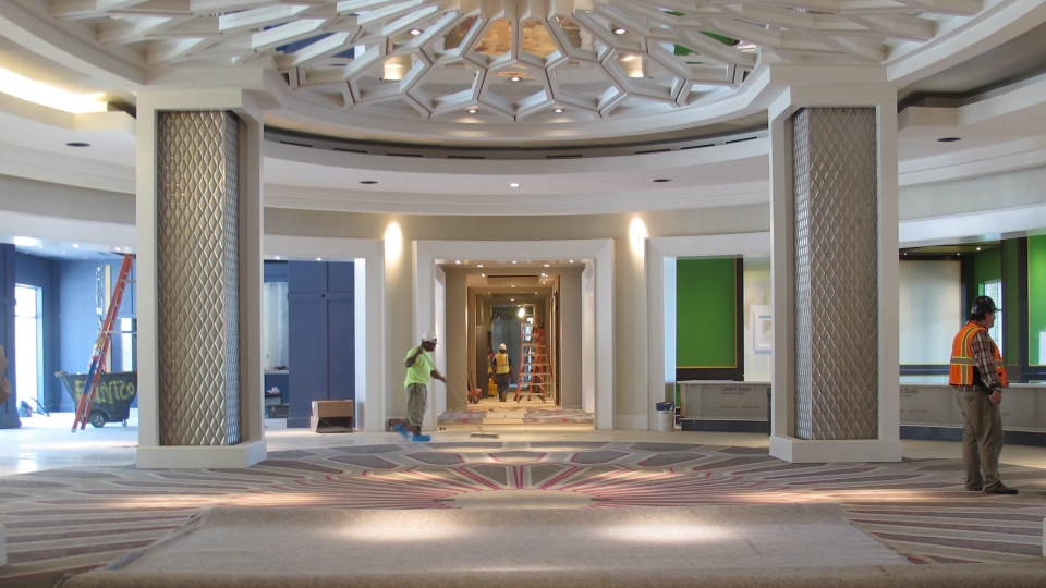 Workers are seen in the circular lobby area of the new 450-room Guest House at Graceland in Memphis, Tenn., on  Aug. 8, 2016. The hotel is set to open Oct. 27. (AP Photo/Adrian Sainz)