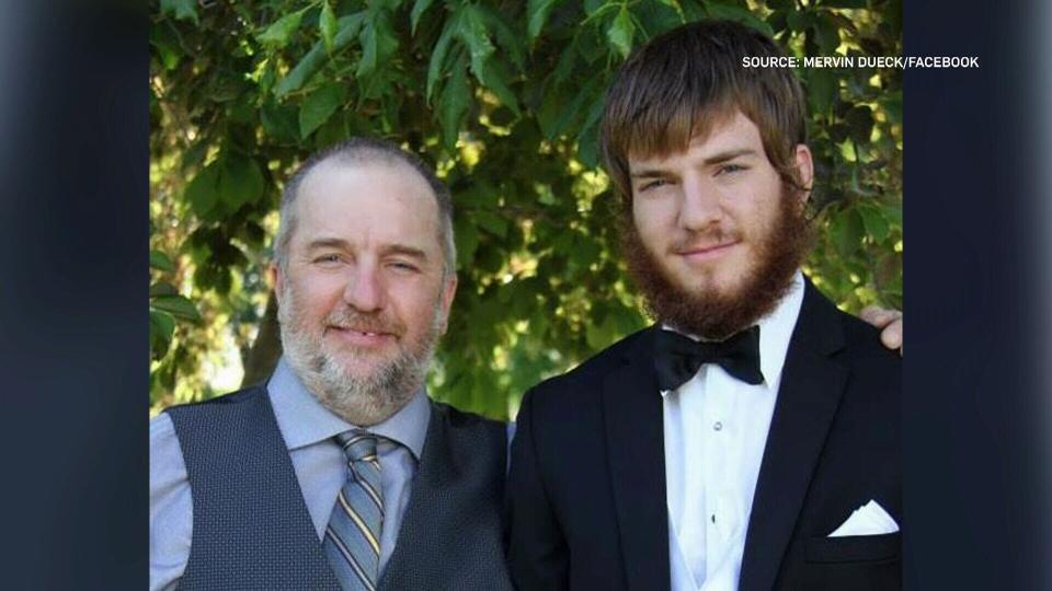Mervin Dueck with his son, Calvin.