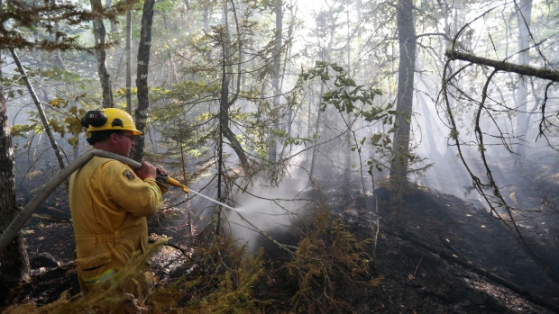 Steve Amero of Hampton battles a wildfire in Seven Mile Lake, N.S. (Communications Nova Scotia)