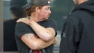 Daniel Ludwig talks with a co-worker after Wednesday afternoon's lightning strike