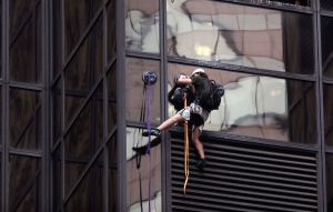 A man scales the all-glass facade of Trump Tower, Wednesday, Aug. 10, 2016, in New York. The 58-storey building is headquarters to the Republican presidential nominee's campaign. (AP / Julie Jacobson)
