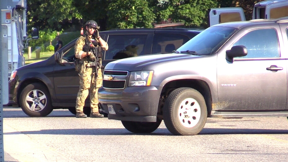 Security officials are seen in Strathroy, Ont., a community about 225 kilometres west of Toronto, where a police operation has been linked to a suspected terrorist threat.