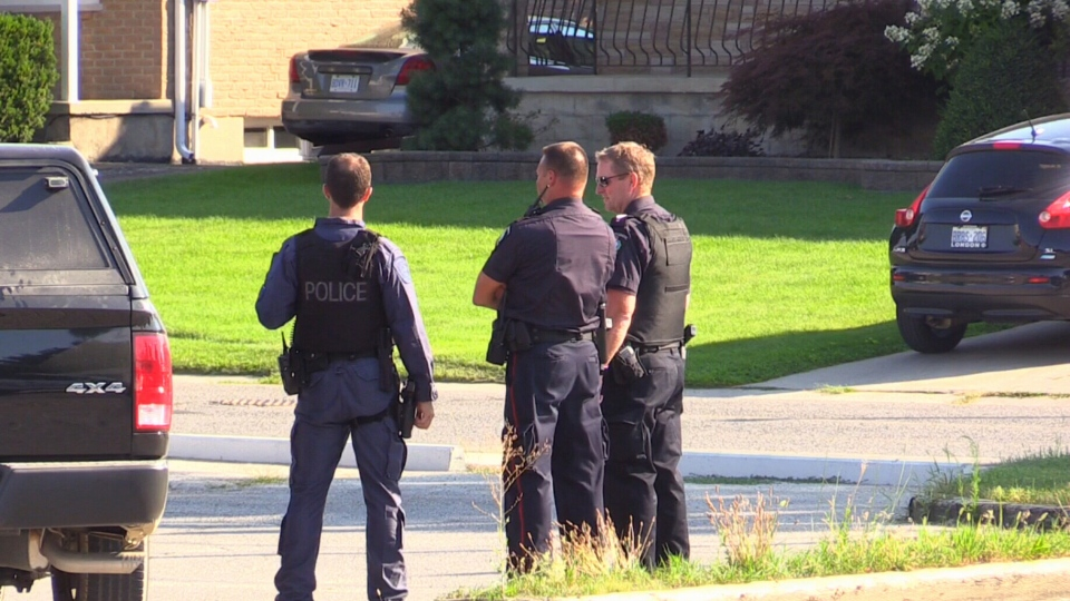 Police officers are seen in Strathroy, Ont., where a police operation has been linked to an alleged terrorist plot.