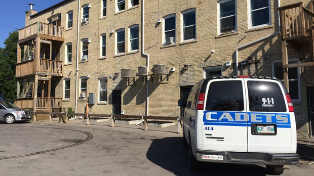 Police are currently on scene in a parking lot at the rear of an apartment building at the corner of McGee Street and Ellice Avenue. (Source: Jamie Dowsett)