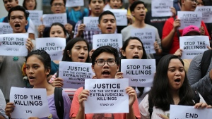 Filipino student activists shout slogans as they call for justice for victims of extrajudicial killings during a rally at the University of the Philippines in suburban Quezon city, north of Manila, Philippines, Thursday Aug. 11, 2016. (AP / Aaron Favila)