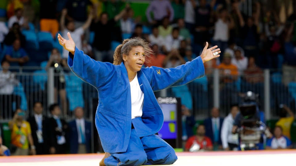 Brazil's Rafaela Silva celebrates after winning the gold medal of the women's 57-kg judo competition at the 2016 Summer Olympics in Rio de Janeiro, Brazil, on Monday, Aug. 8, 2016. (AP / Markus Schreiber)