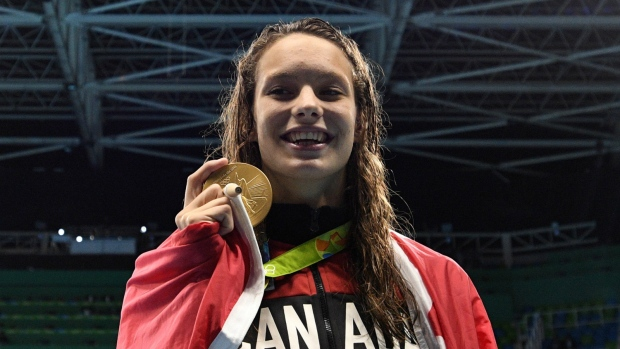 Penny Oleksiak wins gold in 100 metre freestyle