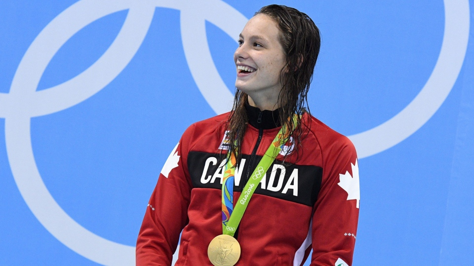 Canada's Penny Oleksiak celebrates her gold medal in the women's 100m freestyle finals during the 2016 Olympic Summer Games in Rio de Janeiro, Brazil, on Friday, Aug. 12, 2016. THE CANADIAN PRESS/Sean Kilpatrick