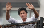 In this Thursday, July 7, 2016, file photo, Bollywood actor Shah Rukh Khan greets fans waiting outside his residence on Eid al-Fitr in Mumbai, India. (AP Photo/Rajanish Kakade, File )