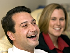 P.E.I. Liberal Leader Robert Ghiz watches the election outcome on television with his wife Kate Ellis Ghiz in his mother's house, May 28, 2007 in Charlottetown.  (CP / Jacques Boissinot)