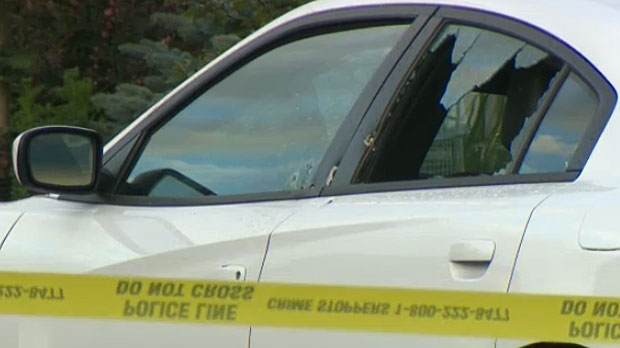 Police say the victim was found in the driver's seat of this white sedan in Panorama Hills early Friday morning.