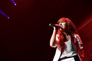 Christina Grimmie performs in concert at the Bridgestone Arena on Friday, Oct. 25, 2013 in Nashville, Tenn. As YouTube stars gathered in Toronto for Saturday's FanFest festivities, they reflected on the death of one of their own, Christina Grimmie who was shot in June while signing autographs after a show in Orlando, Fla. (THE CANADIAN PRESS/AP, Donn Jones)
