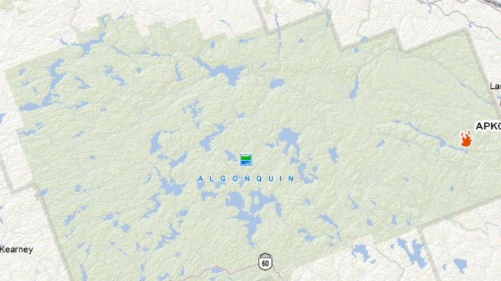 The fire was first discovered Tuesday and has since grown to span 30 hectares near High Falls Lake in the east end of Algonquin Park, outlined in green, according to officials. (Credit: Ministry of Natural Resources)