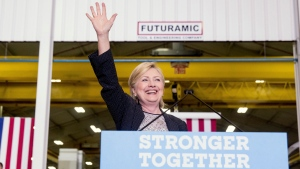 Democratic presidential candidate Hillary Clinton waves as she finishes a speech on the economy after touring Futuramic Tool & Engineering, in Warren, Mich., Thursday, Aug. 11, 2016. (Andrew Harnik/AP Photo)