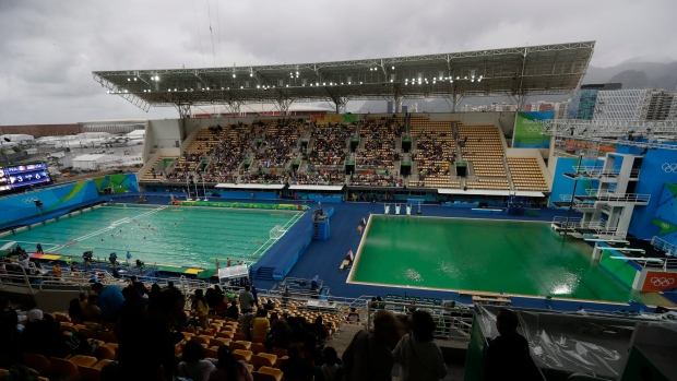 Out of options, Olympic officials opt to drain green pool