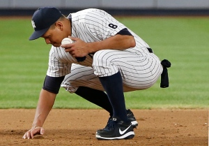 New York Yankees designated hitter Alex Rodriguez gathers dirt from the field near third base in his final game as a Yankee, at Yankee Stadium in New York, Friday, Aug. 12, 2016. (AP / Kathy Willens)