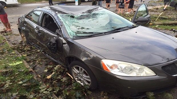 A damaged vehicle is pictured in the area of Ritson Road and Outlet Drive in Oshawa following a powerful storm Saturday August 13, 2016. (Jamie Gutfreund /CP24)