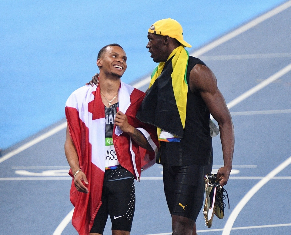 Canada's Andre De Grasse, left, and Jamaica's Usain Bolt share a moment after racing in the men's 100-metre final during the athletics competition at the 2016 Olympic Summer Games in Rio de Janeiro, Brazil on Sunday, August 14, 2016. THE CANADIAN PRESS/Sean Kilpatrick