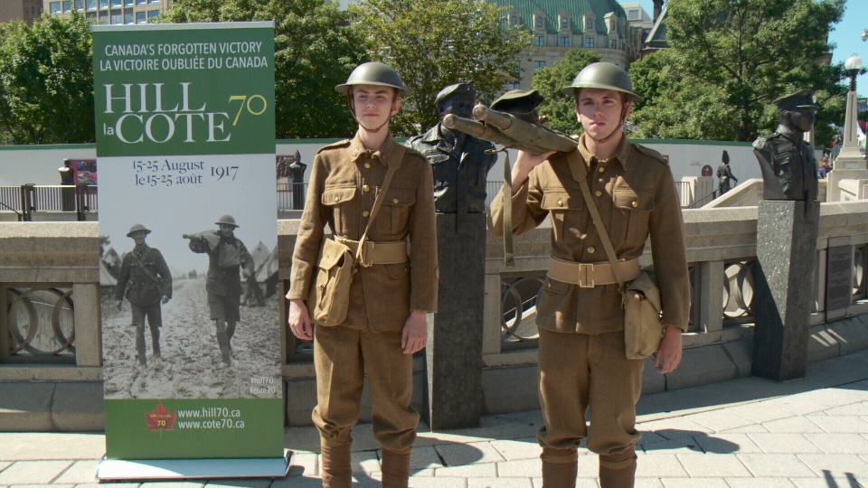 Young actors re-enact a photograph from the Battle of Hill 70 in Ottawa, Aug. 15, 2017
