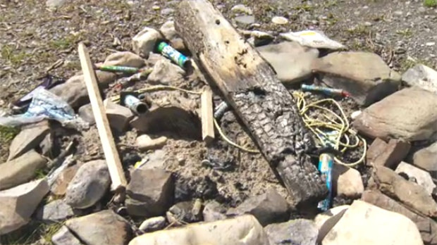 Garbage and shotgun shells litter a make-shift fire pit in the area and officers say it is a regular occurrence.