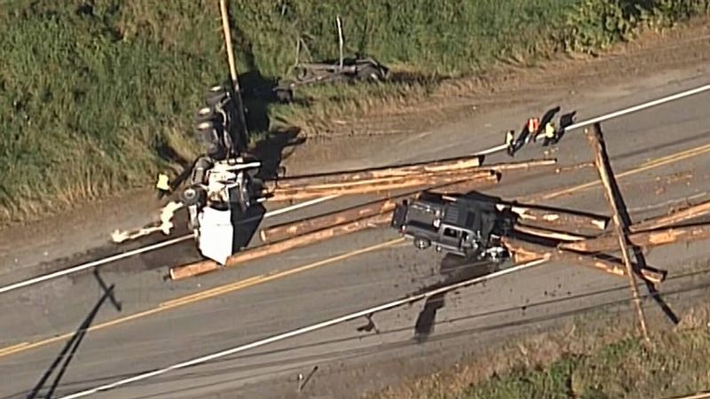A flipped logging truck (left) and damaged pickup are seen from CTV's Chopper 9 over the Lougheed Highway on Monday, Aug. 15, 2016.