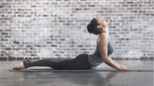 As temperatures drop, head indoors for a hot yoga class this fall. © da-kuk/Istock.com
