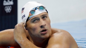 In this Tuesday, Aug. 9, 2016, file photo, United States' Ryan Lochte checks his time in a men's 4x200-meter freestyle heat during the swimming competitions at the 2016 Summer Olympics, in Rio de Janeiro, Brazil. (AP Photo / Michael Sohn, File)