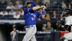 Toronto Blue Jays' Russell Martin watches his two-run home run during the eighth inning of a baseball game against the New York Yankees in New York on Tuesday, Aug. 16, 2016. (AP / Kathy Willens)