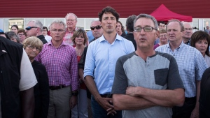 Prime Minister Justin Trudeau joins spectators in singing the national anthem prior to a harness race at the Red Shores Racetrack in Charlottetown, P.E.I. on Tuesday, August 16, 2016. (THE CANADIAN PRESS/Darren Calabrese)