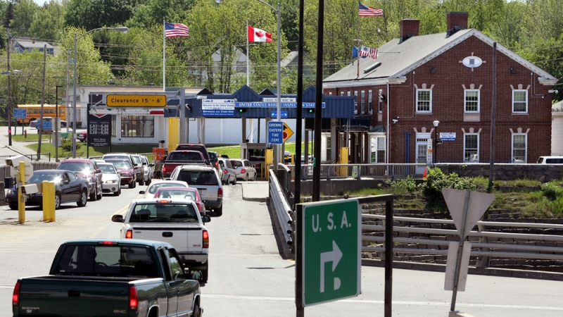 FILE - In this May 30, 2006 file photo, motorists from St. Stephen, New Brunswick, Canada, wait to go through US Customs at Calais, Maine. (AP Photo/Robert F. Bukaty, File)