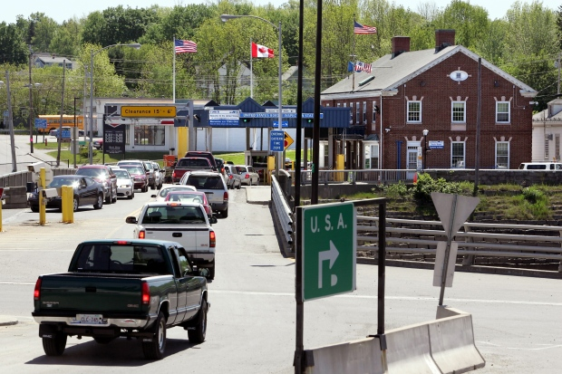 In this 2006 file photo, motorists from St. Stephen, New Brunswick, Canada, wait to go through U.S. Customs at Calais, Maine, at the nation's seventh-busiest crossing on the Canadian border. (AP Photo/Robert F. Bukaty, File)
